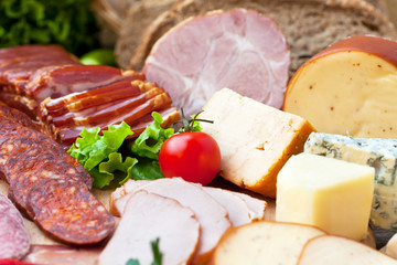 Variety of meat products and cheese