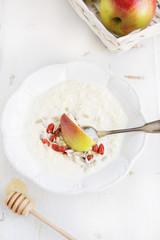 millet porridge with milk,goji berries, apple, honey and seeds