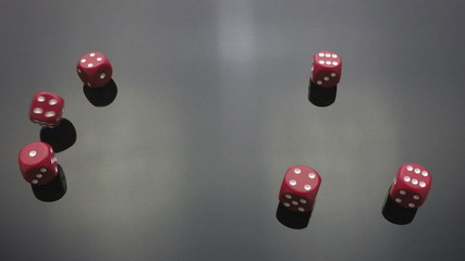 red dice cast on black slow motion