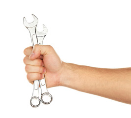 Metal wrenches in male hand isolated on white