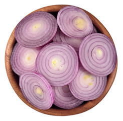 Red onion slices in a wooden bowl on a white