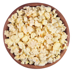 Fresh popcorn in a wooden bowl on a white