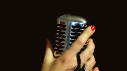 Music microphone female hands fast grab