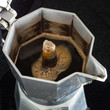 Постер, плакат: Coffee Brewing Process in the Traditional Italian Coffee Maker
