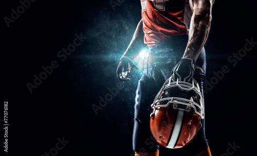 American football sportsman player in stadium - 77076182