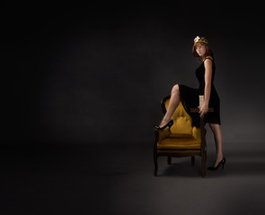 princess in a sensual pose with throne