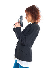 Redhead girl holding a pistol