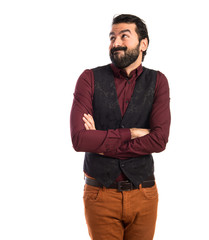 Man wearing waistcoat making unimportant gesture
