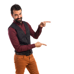 Man wearing waistcoat pointing to the lateral