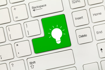 White conceptual keyboard - Lamp symbol (green key)