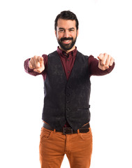 Man wearing waistcoat pointing to the front