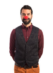Man wearing waistcoat with clown nose