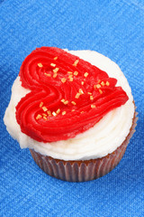 Valentine's day cupcake over a blue background