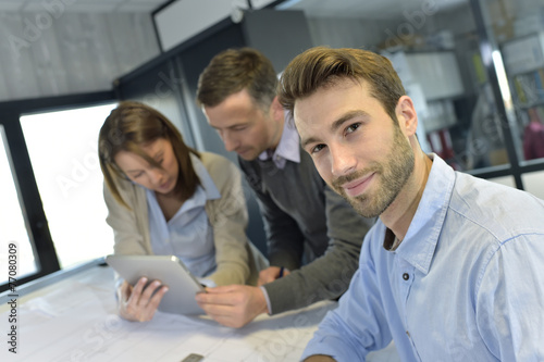 canvas print picture Portrait of architect amongst group in meeting