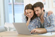 Couple at home websurfing on internet - 77080511