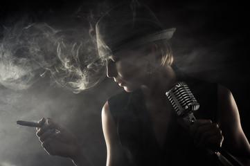 jazz singer with cigar and microphone