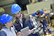 Engineers in steel factory working on digital tablet - 77080947