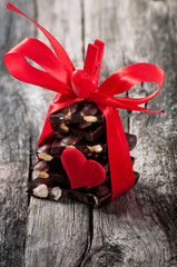 Chokolate on the wooden background