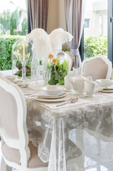 table set in white dinning room