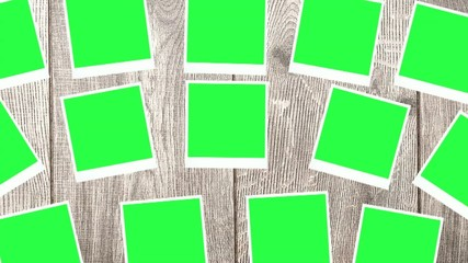 blank photos with a green screen on a wooden background