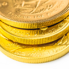 three one ounce golden coins