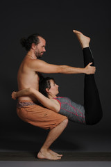 Man and woman doing acro yoga