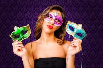 Attractive girl with masks of different colors
