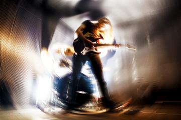 Tocando la guitarra. Fondo abstracto de música. Música rock