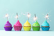 Colorful cupcakes with sparklers - 77088949