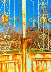 ruined iron made door  in Peleta village in Greece