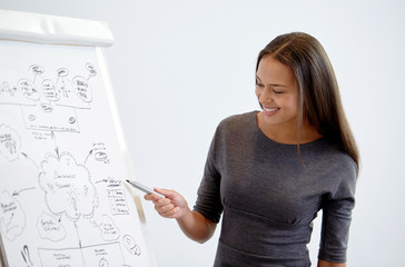 smiling businesswoman on presentation in office