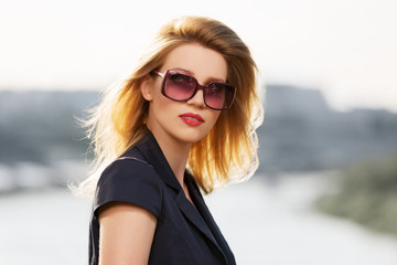 Portrait of young fashion woman in sunglasses outdoor