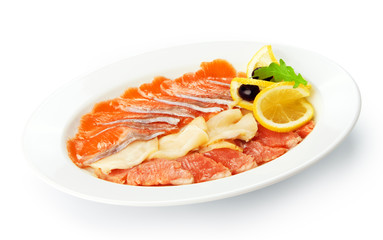 Restaurant food isolated - smoked fish assorted with lemon