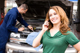 Mechanic: Woman Calling for Ride from Auto Shop - 77091967