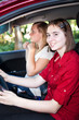 Teenage Girls Driving a Car