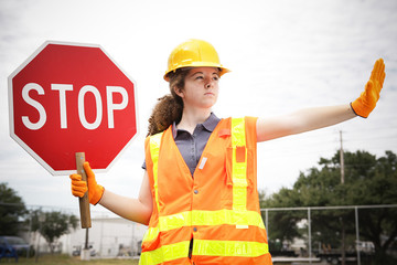 Female Construction Worker Directs Traffic