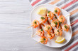 Grilled shrimp on skewers with lemon horizontal top view - 77095979