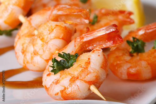 tasty grilled shrimp on wooden skewers macro with sauce - 77097701