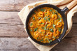 Shrimp in curry sauce in the pan. horizontal top view - 77097959