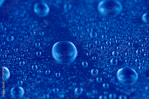Drops of water on blue background © JacobST