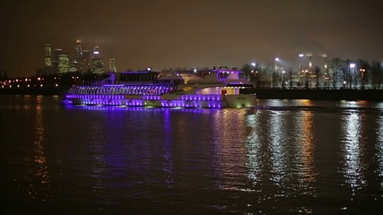 River ship in the evening in the city