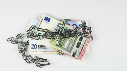 Euro banknotes in chains - stop-motion