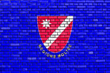 flag of Molise painted on brick wall