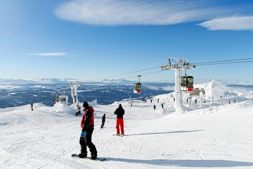 Skiers on the top of the piste