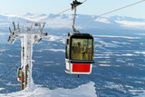 Ski lift reaching the top - 77100357