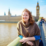 Young tourist in London on Westminster bridge