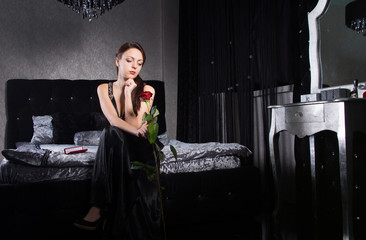 Sitting Woman in Black Dress Holding Rose Flower