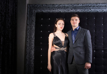 Young Couple in Elegant Outfits Looking at Camera