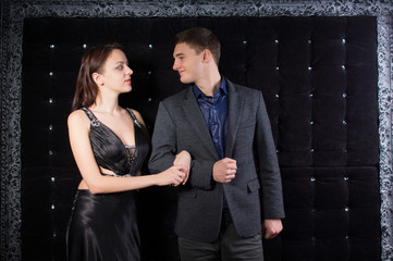 Couple Looking Each Other in Elegant Clothing