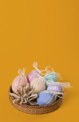 Colorful Easter eggs with bows vertical greeting card